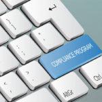 compliance program written on the keyboard button
